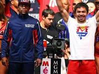 Floyd Mayweather Jr., left, and Manny Pacquiao pose with a WBC belt during a press conference Wednesday, April 29, 2015, in Las Vegas. Mayweather will face Pacquiao in a welterweight boxing match in Las Vegas on May 2.