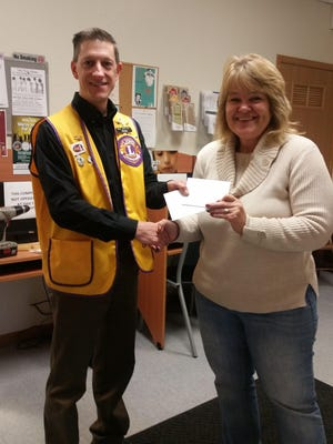 The Maine Lions Club recently donated $1,300 to the Wausau Community Warming Shelter. Lion Nick Schock is shown presenting the donation to Barbara Sugden, warming center coordinator. Many residents from our community are helped here.