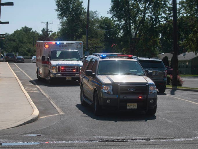 An ambulance leaves Kennedy University Hospital in Stratford after a husband shot and killed his wife, then shot himself, inside a hospital room Wednesday morning, August 27, 2014.
