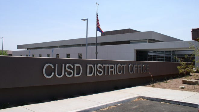 A sign sits outside of the Chandler Unified School District office.