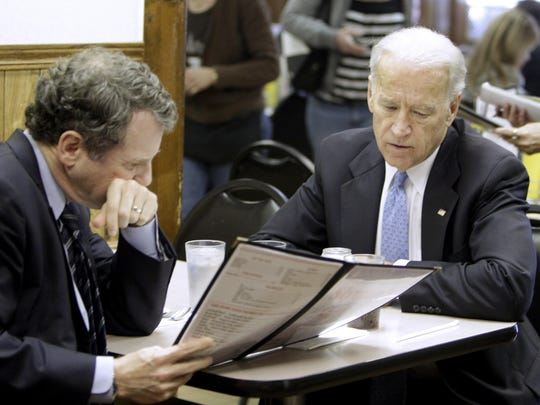 Vice President Joe Biden, right, and Sen. Sherrod Brown, D-Ohio, look over their menus at Slyman's restaurant in Cleveland in 2011. Biden was to attend a fundraiser for Brown later in the day.