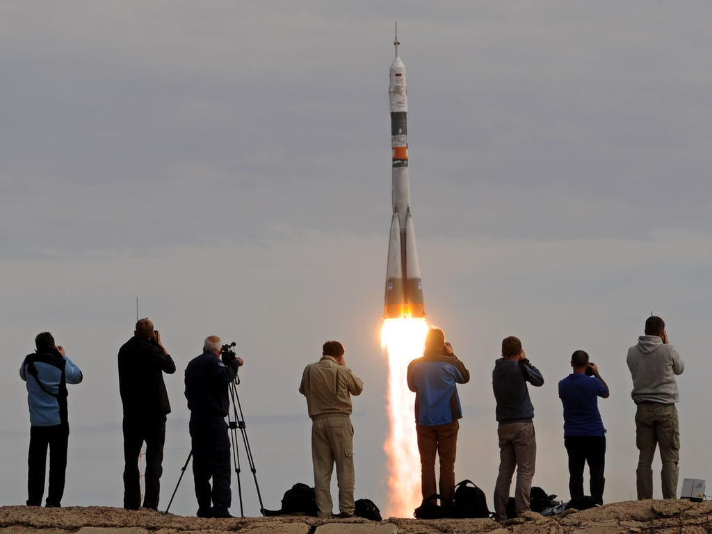 Russia's Soyuz TMA-18M spacecraft, carrying the International Space Station crew of Kazakh cosmonaut Aydyn Aimbetov, Russian cosmonaut Sergei Volkov and Danish astronaut Andreas Mogensen from the European Space Agency, blasts off from the launch pad