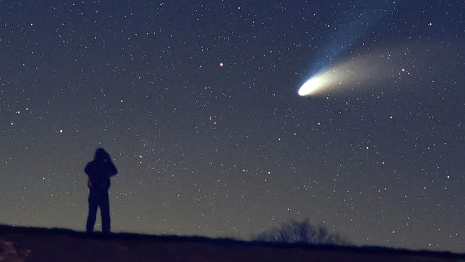 Adam Horne uses binoculars to gaze at Comet Hale-Bopp over Grandfather Mountain in this March 31, 1997, photo. Hale-Bopp was the last bright comet to appear in the skies for northern hemisphere observers. Another bright comet, Comet NEOWISE, is currently making an appearance and will remain visible in the evening sky into August.