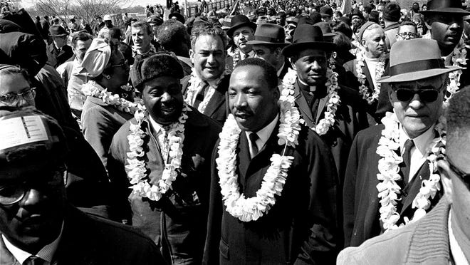 Dr. Martin Luther King Jr. and civil rights marchers cross the Edmund Pettus Bridge in Selma, Ala., heading for the capitol in Montgomery on March 21, 1965.