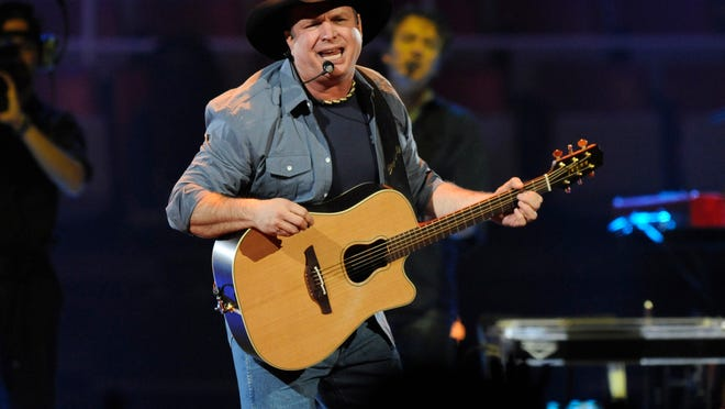 Garth Brooks performs for the crowd at Joe Louis Arena, Friday, February 20, 2015.