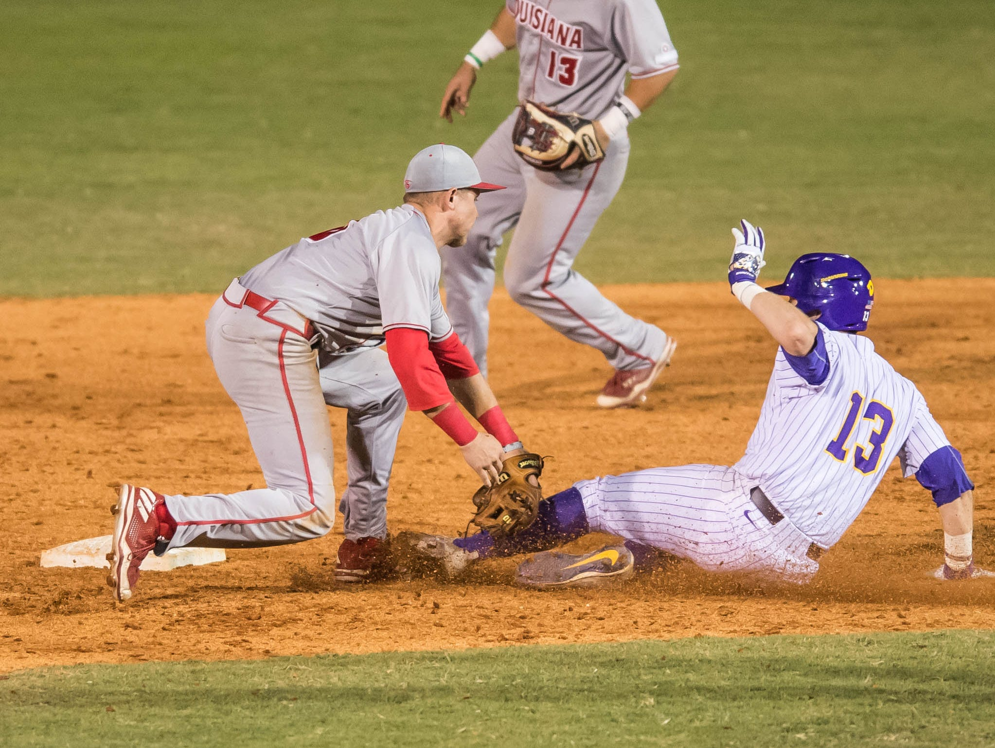 Cajuns infielder Brad Antchak (10) puts the tag on LSU catcher Nick Coomes (13) for the out in the annual Wally Pontiff classic at Zephyr Field on Tuesday night on April 11, 2017.