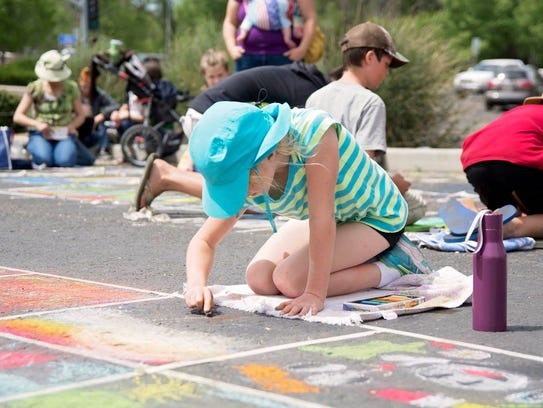People of all ages can create chalk-art drawings on