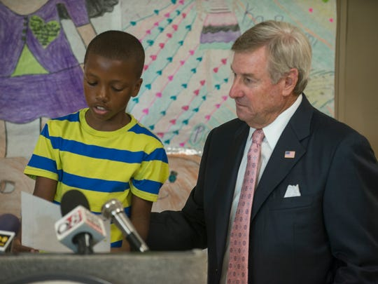 Montgomery Mayor Todd Strange listens as LaGreco Sankey, 4th grade, reads a letter he wrote about the Brain Forest program. Officials gathered Thursday, July 16, 2015, at Carver High School in Montgomery to discuss the Brain Forest Summer Learning program, a pilot program of the Montgomery Education Foundation.