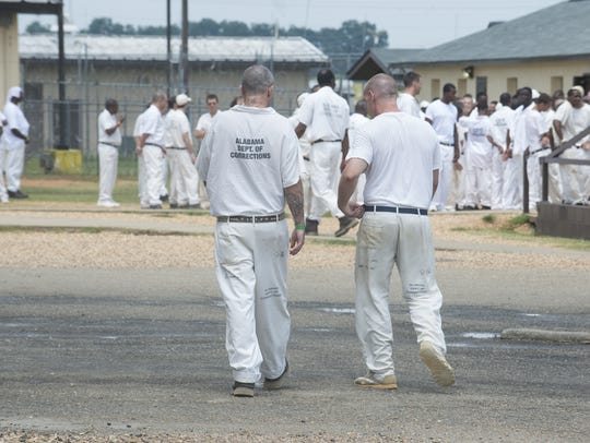 Inmates in the yard of Elmore Correctional Facility on Thursday, July 17, 2015.