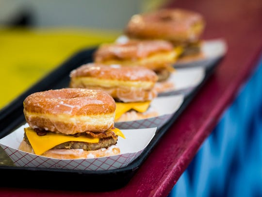Busken's sells cheeseburgers with donut buns at Oktoberfest.