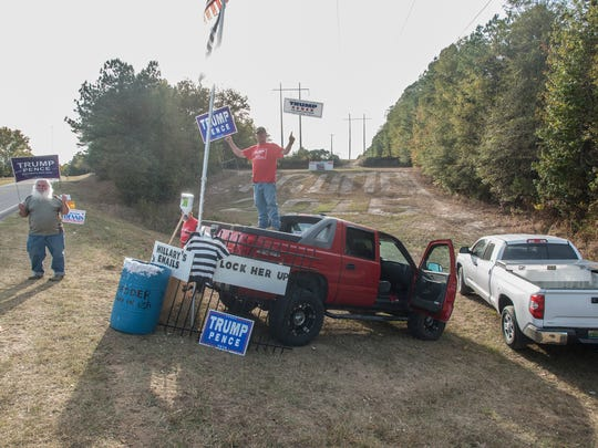 "Robert Moncrief stands on his truck supporting Donald Trump for president on Tuesday, Nov. 8, 2016, in the Santuck community on Central Plank Road in Elmore County. Behind him, he had carved ""Trump 2016"" into the hillside."