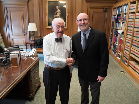 Richard Bell poses with retired Supreme Court Justice John Paul Stevens after photographing him for his book on World War II veterans.