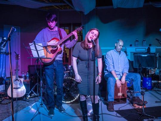 Britt Johnson sang original songs at a benefit concert