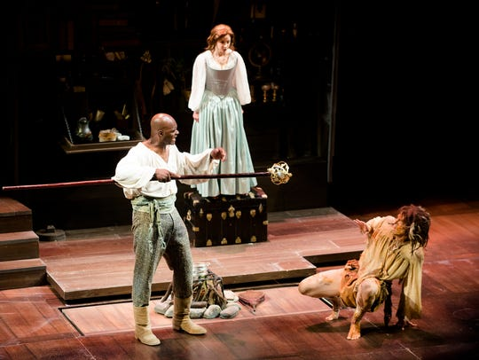 Esau Prtichet as Prospero reprimands his servant, Caliban (Brik Berkes) as his daughter Miranda (Christina King) watches. This was Geoffrey Sherman's last Shakespeare production to direct at the Alabama Shakespeare Festival.