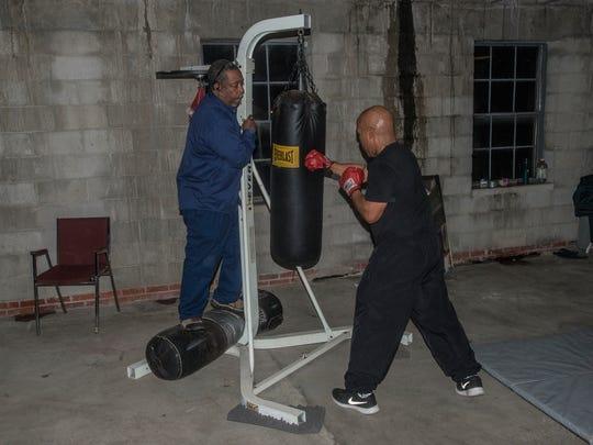 Sarge Ruffin, 60, hits the bag with some help from coach T.C. Collins on Monday, Jan. 8, 2018, at Faith Boxing in Montgomery. It's been 30 years since Ruffin was in an official amateur boxing match, and he'll have one this weekend at the Sugar Bert Boxing National Qualifier at Montgomery's Cramton Bowl Multiplex.