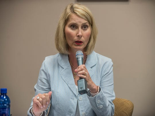 Melissa Snowden (R) participates in a forum the Montgomery