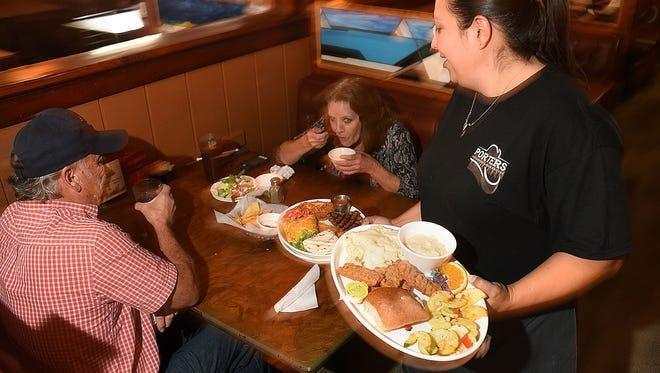 Server Karina Kinsel serves lunch on Monday at Porter's Restaurant in Farmington.
