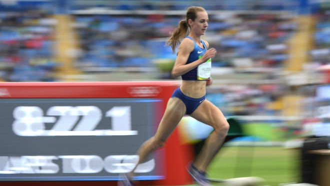 Molly Huddle sets an American record in the 10,000.
