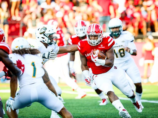 UL running back Trey Ragas gains yardage against SLU on Saturday night.