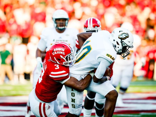 UL defensive end Joe Dillon tackles Southeastern Louisiana quarterback Lorenzo Nunez in the Cajuns' win Saturday night.