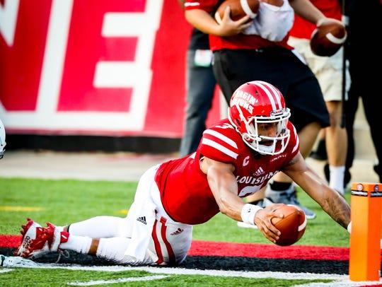 UL quarterback Jordan Davis dives and comes up just