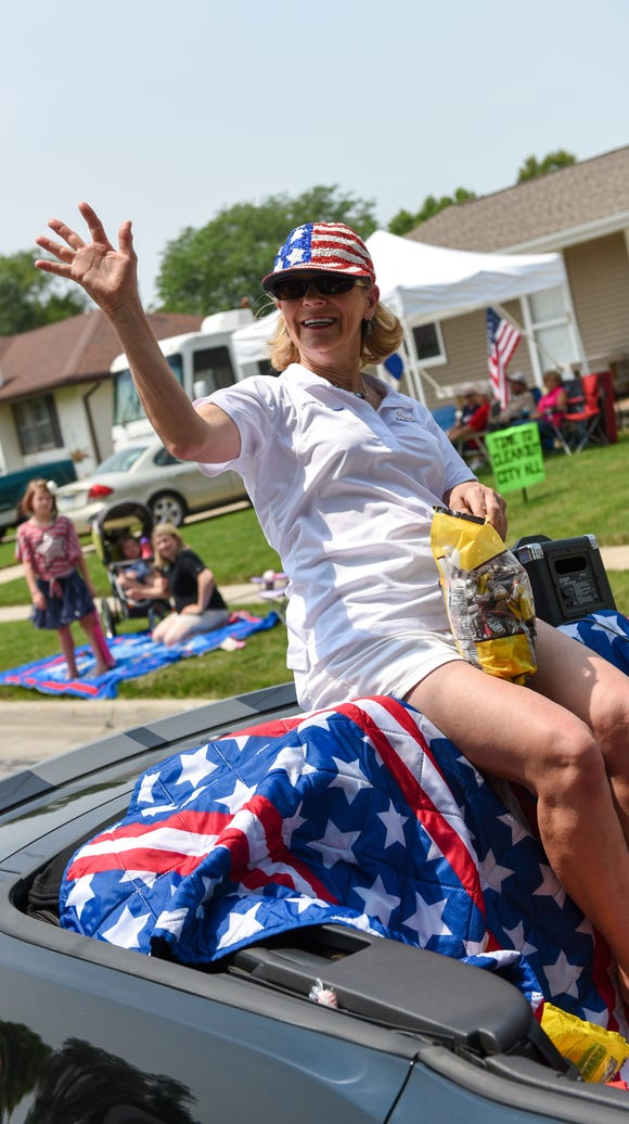 Waukee citizen of the year Terry Snyder throws candy to the kids during the Fourth of July parade in 2015.