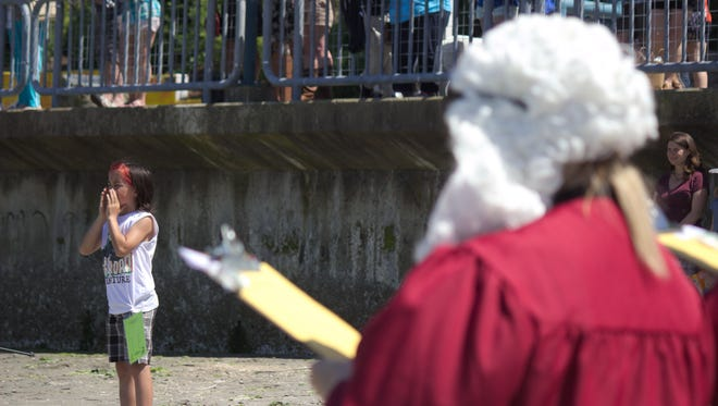 Teo Aguilo, of Port Orchard, makes his seagull call during Port Orchard's annual Seagull Calling Festival on Saturday, May 27, as a panel of judges looks on.