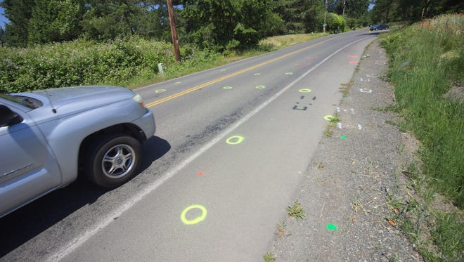 Investigative markings line Finch Road near where two joggers were hit by a vehicle on June 17.