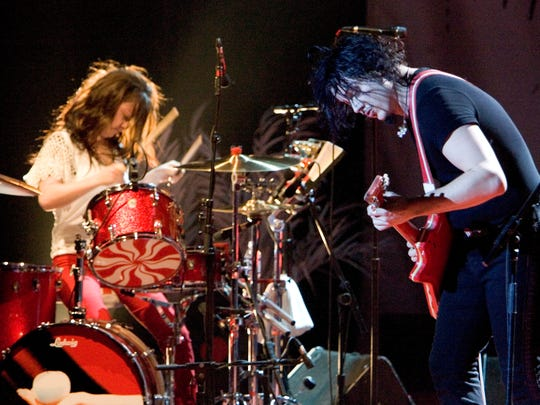 With Meg White on drums and Jack White on guitar, Detroit's own White Stripes rock the Masonic Temple in Detroit on Sept. 30, 2005.