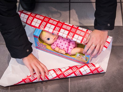 A doll is wrapped during Secret Families at Toyota