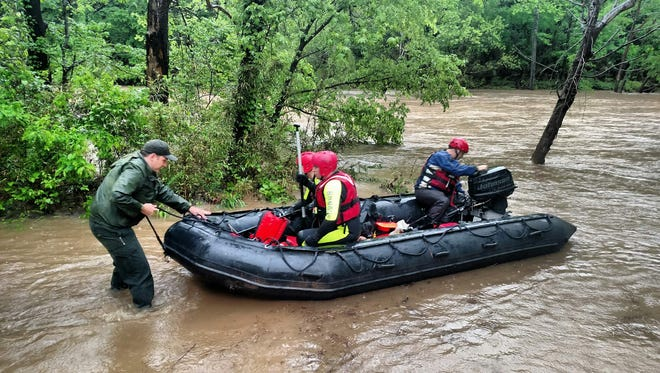 Searchers last weekend scoured the rain-swollen Buffalo National River for a missing canoeist.