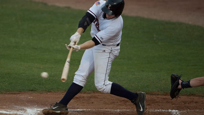 Evansville's Dane Phillips singles against the River City Rascals during their game at Bosse Field Wednesday night. Phillips went 2-4 with a walk on the night. The night before he hit three home runs in one game.