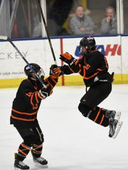 Brighton's Evan MacDonald (right) celebrates his third-period