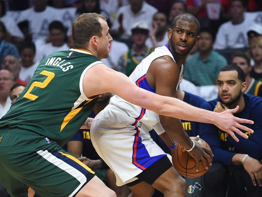 The Clippers' Chris Paul looks for someone to pass