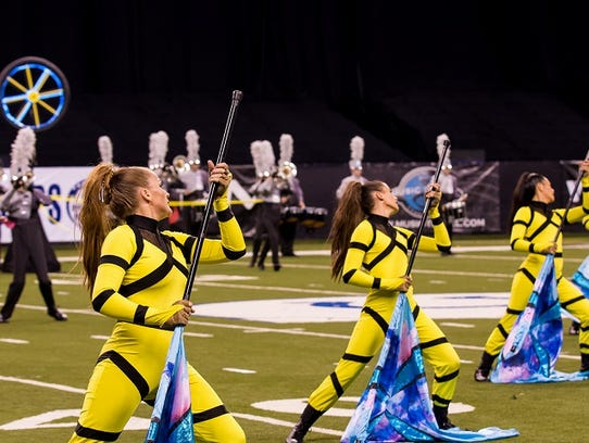The P-CEP color guard performs at Lucas Oil Stadium