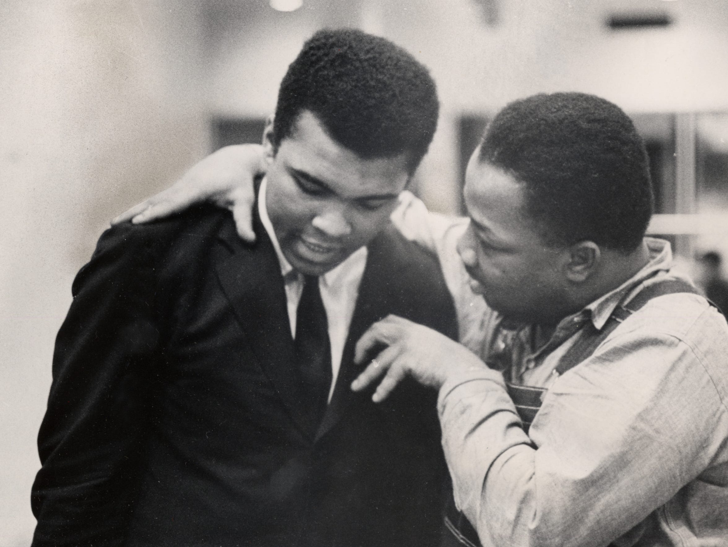 The Rev. A.D. Williams King, right, chats with another