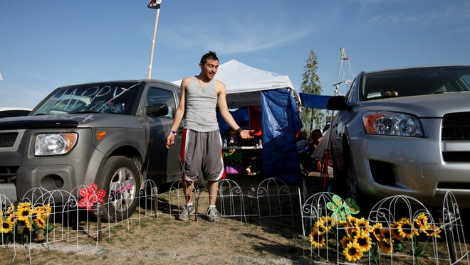 Camper Alex Amaya, 21, of Los Angeles talks about camping in the campgrounds during the 2011 Coachella Valley Music and Arts Festival at the Empire Polo Club in Indio.