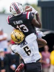 South Carolina Gamecocks wide receiver Shi Smith makes a reception over Vanderbilt Commodores safety Zaire Jones in the first half at Williams-Brice Stadium.