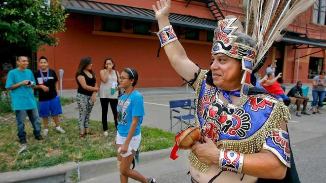 Cresencio Hernandez waves to parade goers during Topeka's annual Fiesta Mexicana Parade in 2013. National Hispanic Heritage Month runs from Sept. 15 through Oct. 15.