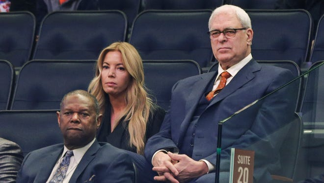 Los Angeles Lakers executive Jeanie Buss, left, sits next to Phil Jackson, right, president of the Knicks, in this April 15, 2015 file photo.