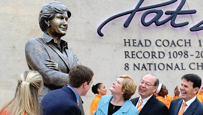 Tennessee women's basketball coach emeritus Pat Summitt, center, looks at the statue unveiled in her honor on Nov. 22,  2013 in Knoxville. With Summitt are (from left) her daughter-in-law AnDe Summitt, son Tyler Summitt, UT Chancellor Jimmy Cheek and director of athletics Dave Hart.