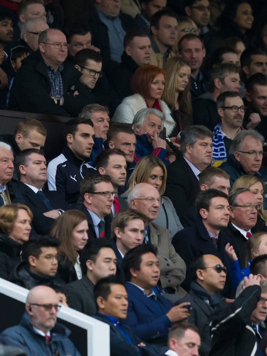 Leicester's Jamie Vardy, upper centre left, watches from the stands during the English Premier League soccer match between Manchester United and Leicester at Old Trafford Stadium, Manchester, England, Sunday, May 1, 2016. (AP Photo/Jon Super)
