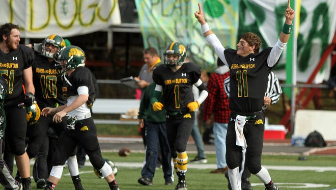 Burr and Burton quarterback Griffin Stalcup celebrates following the Bulldogs' 28-7 win over Bellows Falls in the Division II state high school football championship game on Saturday, Nov. 7, 2015.