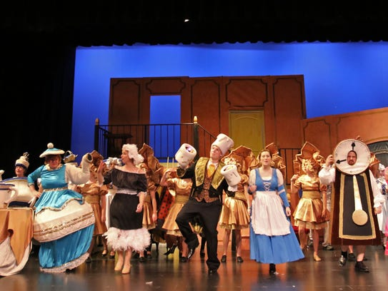The cast performs a musical number in the West Performing