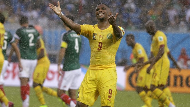 Cameroon's Samuel Eto?o gestures  during the group A World Cup soccer match between Mexico and Cameroon in the Arena das Dunas in Natal, Brazil, Friday, June 13, 2014.  (AP Photo/Ricardo Mazalan)