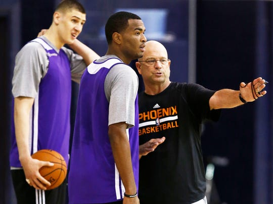Suns rookie forward T.J. Warren talks with coach Jerry Sichting (right) during training camp on Wednesday, Oct. 1, 2014 at NAU's Rolle Activity Center in Flagstaff, AZ.