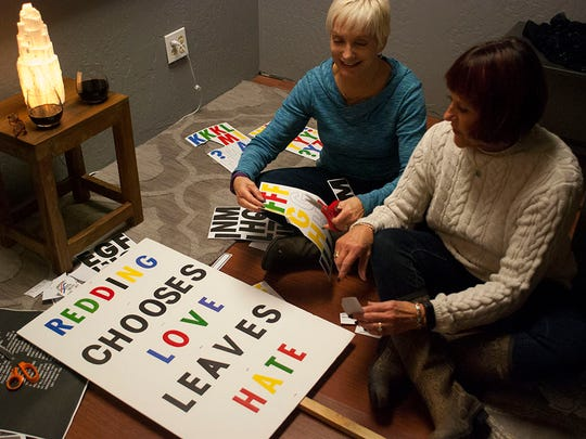 Lynne Pearson, left, and Linda Masterson create a sign in Redding for a Women's March in Sacramento.
