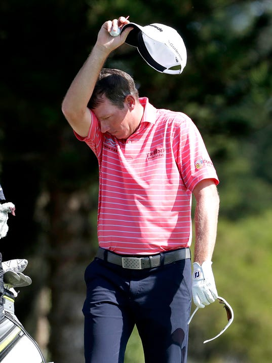 Jim Herman wipes his brow on the second tee during the first round of the Tournament of Champions golf event, Thursday, Jan. 5, 2017, at Kapalua Plantation Course in Kapalua, Hawaii. (AP Photo/Matt York)