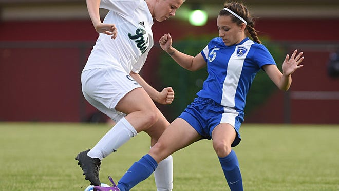 Kristen Slomba, left, fights for control of the ball during a 2015 sectional girls soccer match between Notre Dame and Limestone.