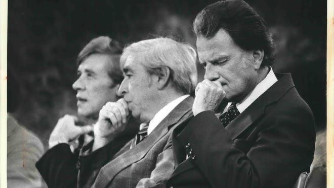 Milwaukee Mayor Henry Maier (left) and County Executive William O'Donnell (center) sit with the Rev. Billy Graham during his 1979 crusade at Milwaukee County Stadium.